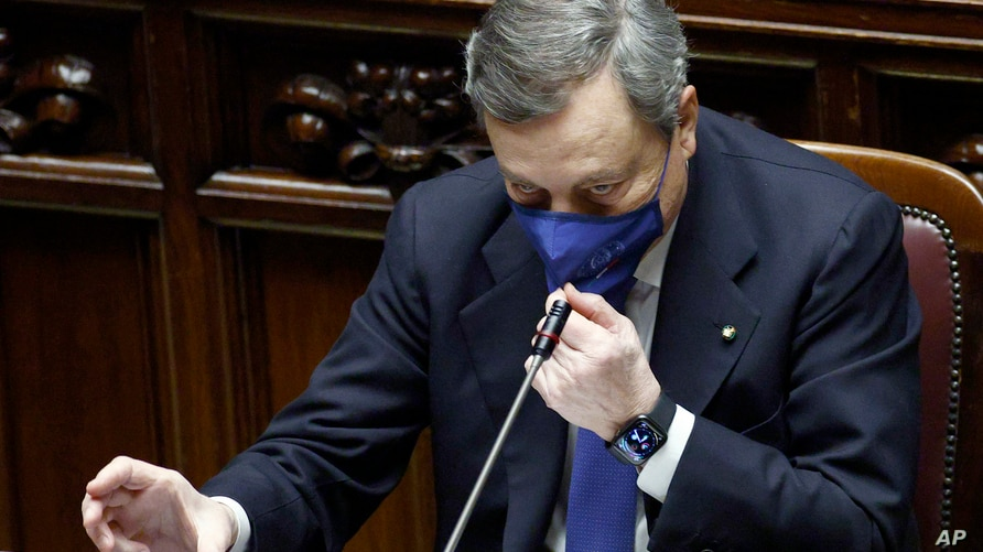 FILE - Italy's Prime Minister Mario Draghi addresses the Lower Chamber of the Italian Parliament, in Rome, Feb. 18, 2021, ahead of a confidence vote that would mark the start of his government.