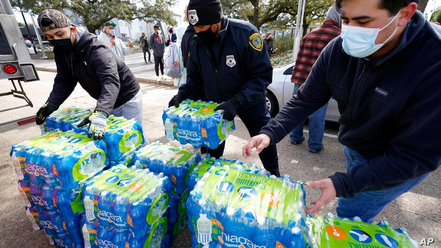 Donated water is distributed to residents, Thursday, Feb. 18, 2021, in Houston. Houston and several surrounding cities are…