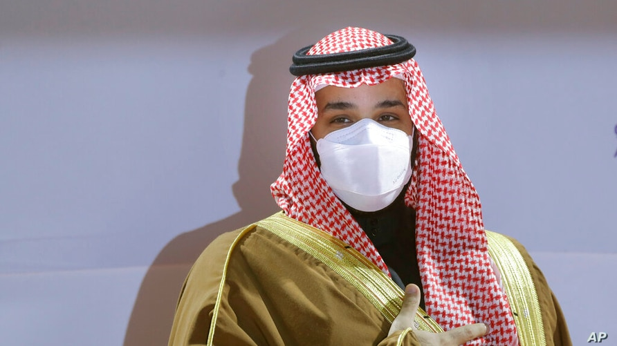 Saudi Crown Prince Mohammed bin Salman wears a face mask to help curb the spread of the coronavirus as he attends the Saudi Cup…
