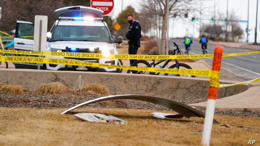 A piece of debris from a commercial airplane is marked off by police tape where it landed along Midway Boulevard in Broomfield,…