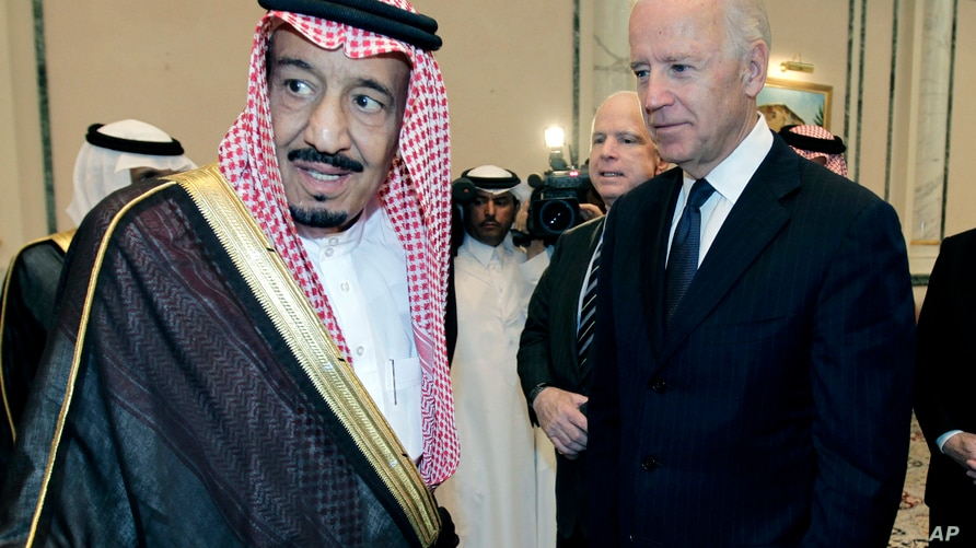 FILE - In this Oct. 27, 2011 file photo, then U.S. Vice President Joe Biden, right, offers his condolences to then Prince…