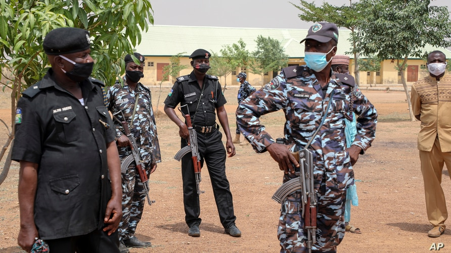 Security forces guard the Government Girls Junior Secondary School where more than 300 girls were abducted by gunmen on Friday, in Jangebe town, Zamfara state, northern Nigeria, Feb. 28, 2021.