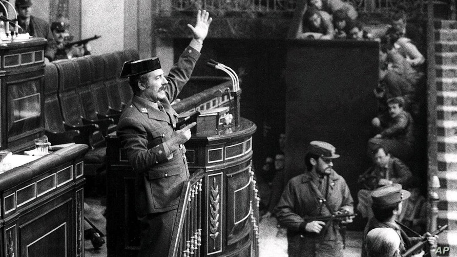 Antonio Tejero, Spanish Civil Guard, raises arm during an attempted coup in the Spanish Parliament, Madrid, Spain, Feb. 23, 1981.