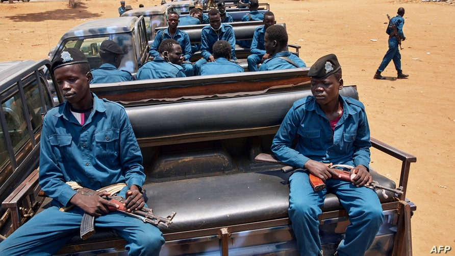 FILE - Police officers sit on the back of pickup trucks as the prepare to patrol the streets of Juba, South Sudan, April 9, 2020.