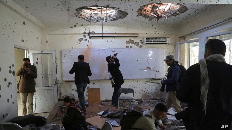 Journalists photograph inside Kabul University after a deadly attack in Kabul, Afghanistan, Nov. 3, 2020.