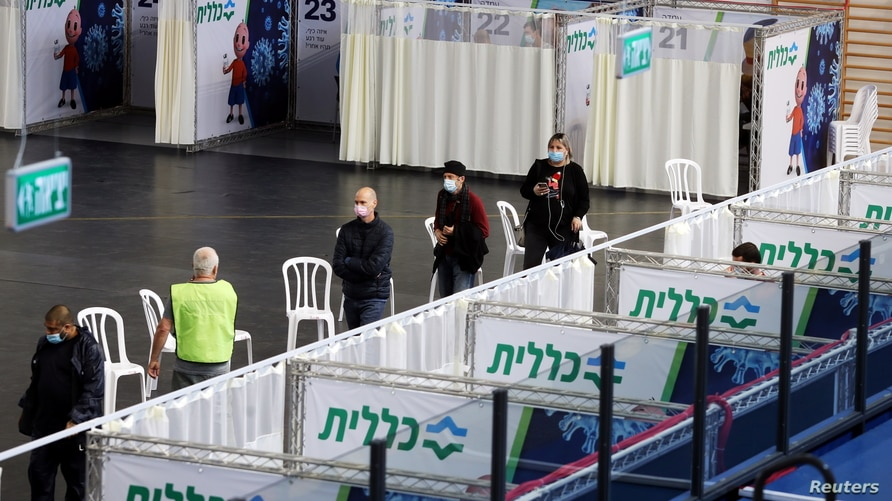 FILE - People queue to receive a vaccine against COVID-19 at a makeshift vaccination site in Petah Tikva, Israel, Jan. 28, 2021.