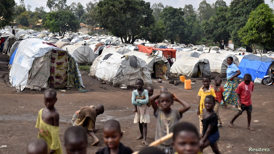 FILE - Congolese children are seen at a makeshift camp for internally displaced people in Bunia, Ituri province, eastern Democratic Republic of Congo, June 25, 2019.