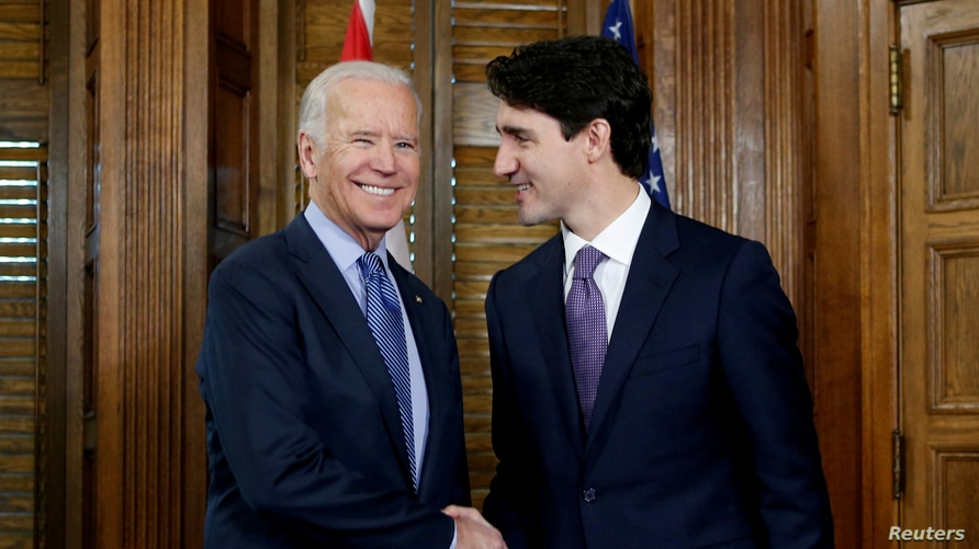 FILE - Canada's Prime Minister Justin Trudeau (R) shakes hands with then U.S. Vice President Joe Biden during a meeting in Trudeau's office on Parliament Hill in Ottawa, Ontario, Canada, Dec. 9, 2016.