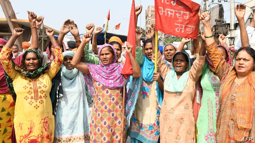 Women activists from Mazdoor Sabha shout slogans on the occasion of International Women's Day as they demonstrate against the…