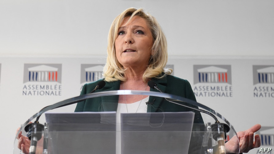 President of the French far-right party Rassemblement National (RN) and MP Marine Le Pen gives a press conference to present a…