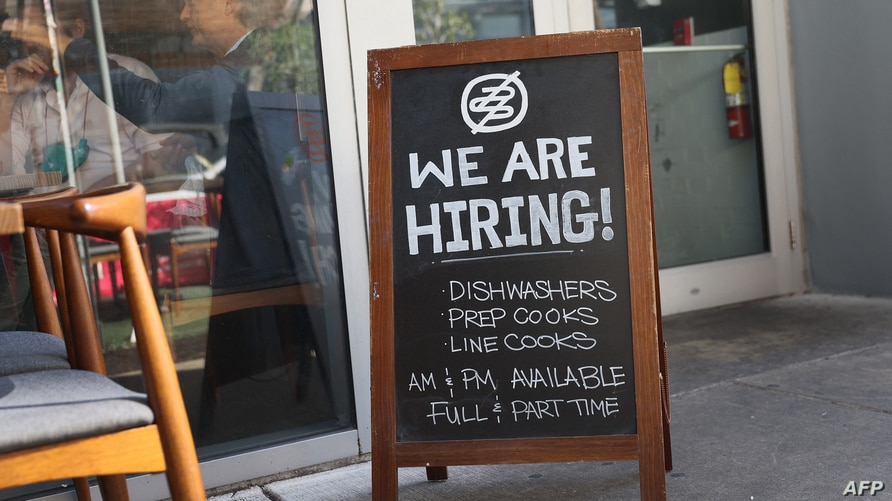 (FILES) In this file photo taken on March 05, 2021, A 'we are hiring sign' in front of the Buya restaurant in Miami, Florida. -…