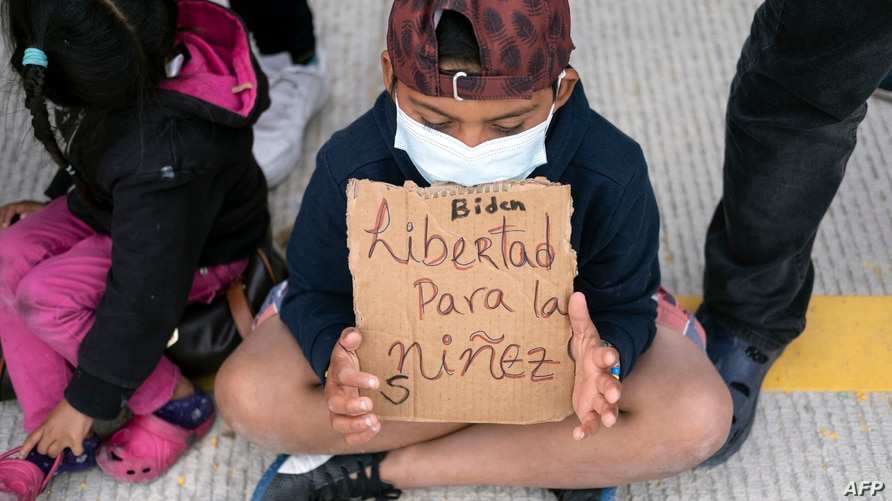 Migrants and asylum seekers demonstrate at the San Ysidro crossing port asking US authorities to allow them to start their…