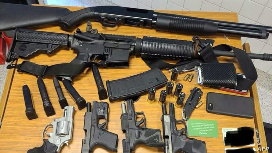 This image released by the Atlanta Police Department on March 25, 2021, show weapons taken from a suspect arrested at a Publix…