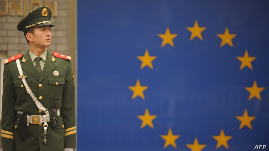 A Chinese paramilitary policeman stands guard outside the European Union Delegation in Beijing on November 1, 2011.