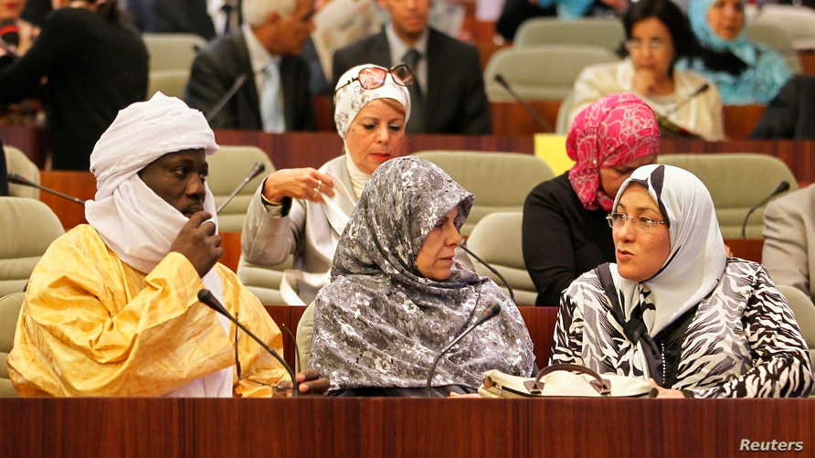 Delegates talk during the opening session of the new National Assembly in Algiers May 26, 2012. Algeria has the largest…