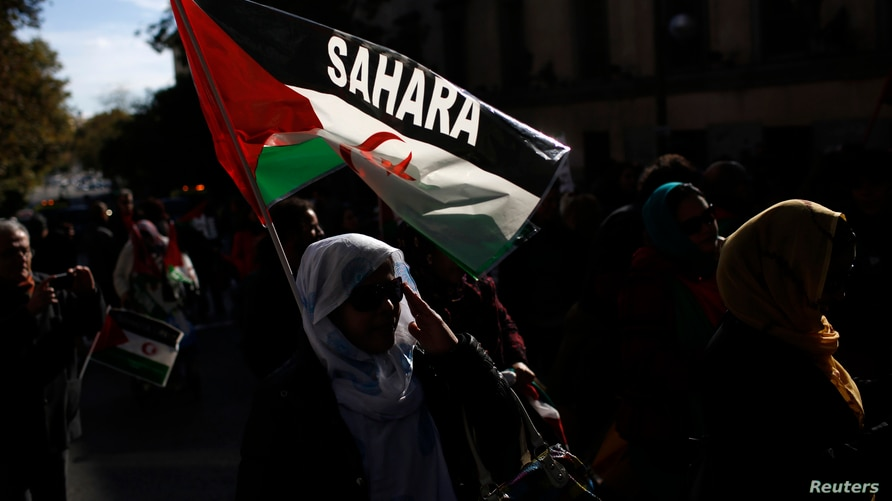 FILE - Protesters in Madrid, Spain, take part in a demonstration in support of Western Sahara's independence.
