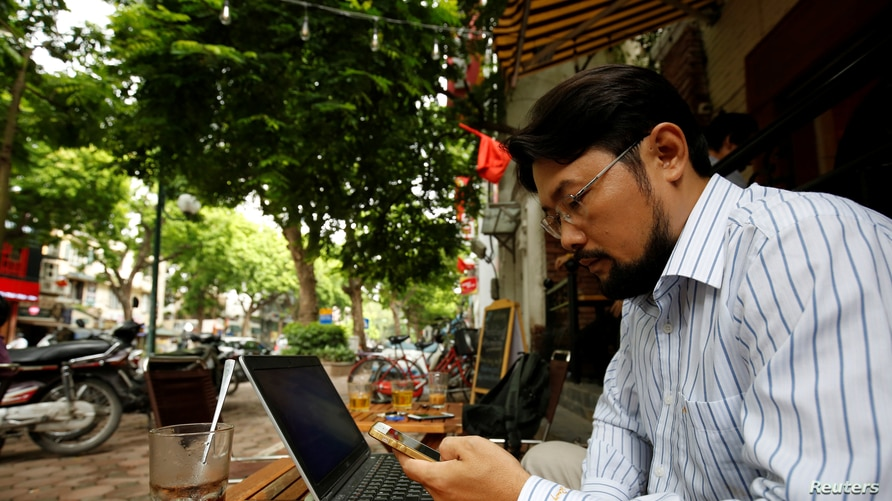 Vietnamese activist Anh Chi searches the Internet at Tu Do (Freedom) cafe in Hanoi, Vietnam August 25, 2017. Picture taken on…
