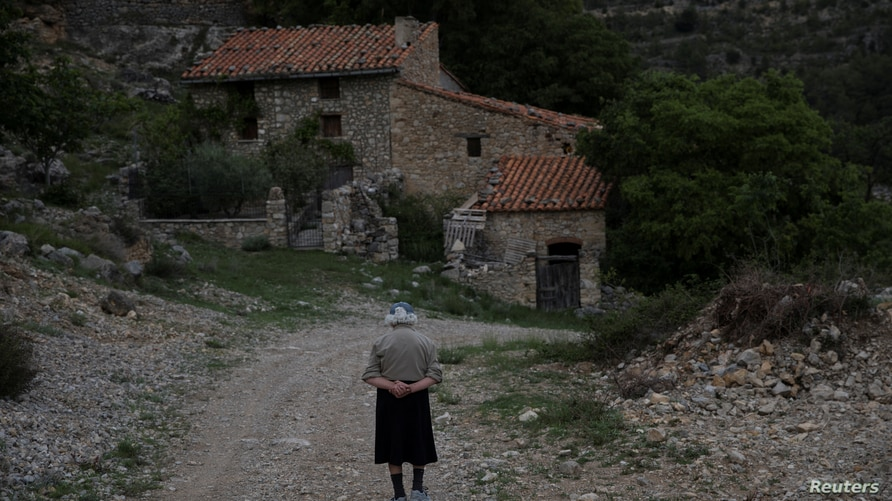 Sinforosa Sancho, 84, takes a walk in the empty village of La Estrella, Spain, May 24, 2018. For more than 30 years, Sinforosa…