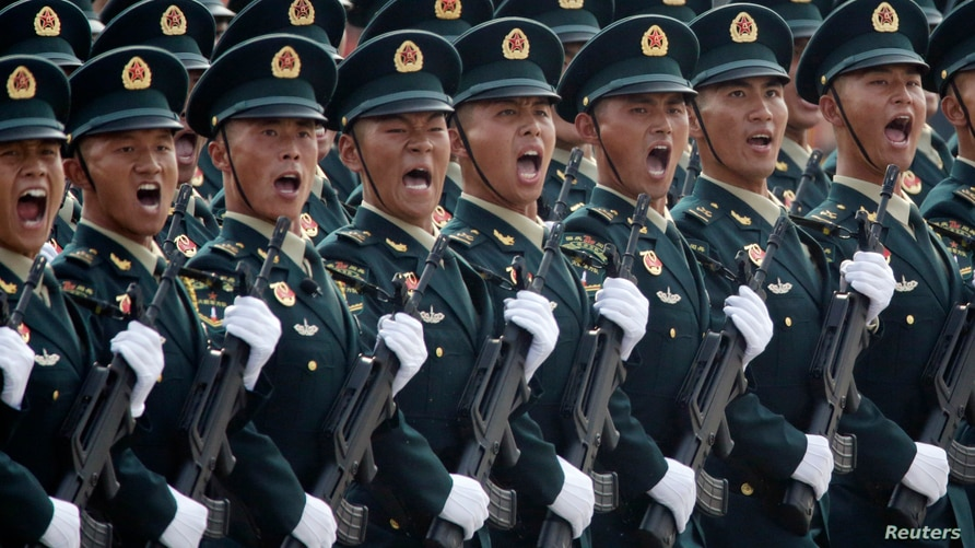 Soldiers of People's Liberation Army (PLA) march in formation past Tiananmen Square during the military parade marking the 70th…