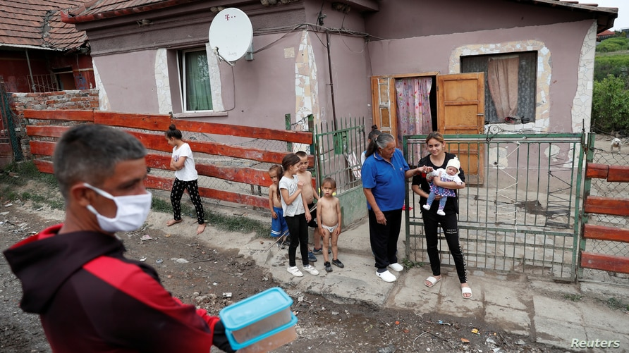 A Roma activist carries food donation during the COVID-19 outbreak in Miskolc, Hungary April 30, 2020.