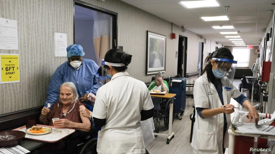 Nursing home residents receive a shot of the coronavirus disease (COVID-19) vaccine at King David Center for Nursing and…
