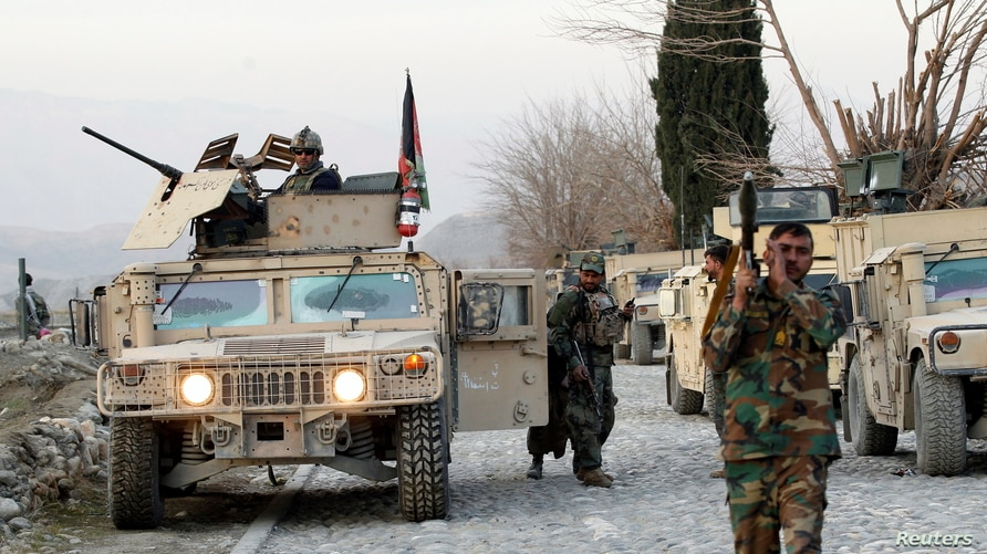 Afghan National Army soldiers inspect the site of a car bomb attack on a military base in Shirzad district of Nangarhar…