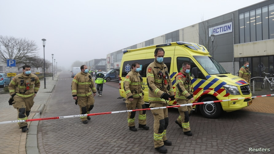 Emergency responders secure the area at the scene of an explosion at a coronavirus disease (COVID-19) testing location in…