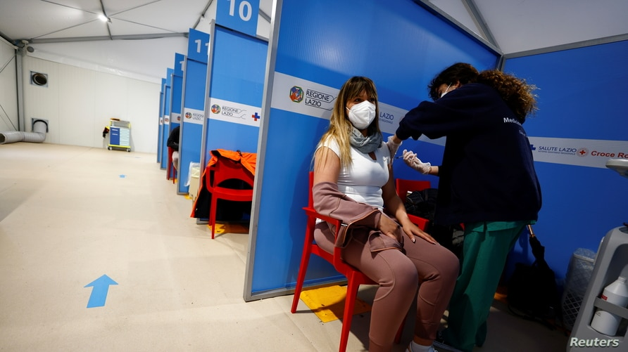 A medical worker injects the AstraZeneca coronavirus disease (COVID-19) vaccine at Fiumicino Airport in Rome, Italy March 8,…