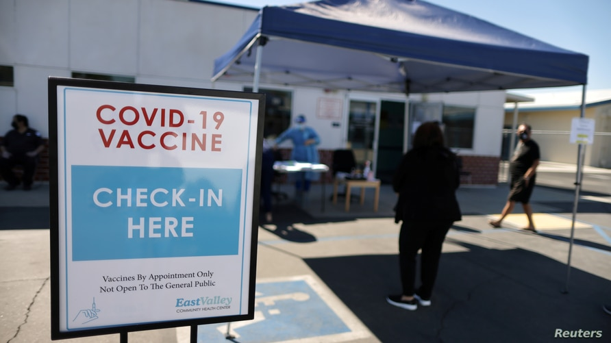 FILE PHOTO: People arrive for coronavirus disease (COVID-19) vaccinations, at East Valley Community Health Center in La Puente,…