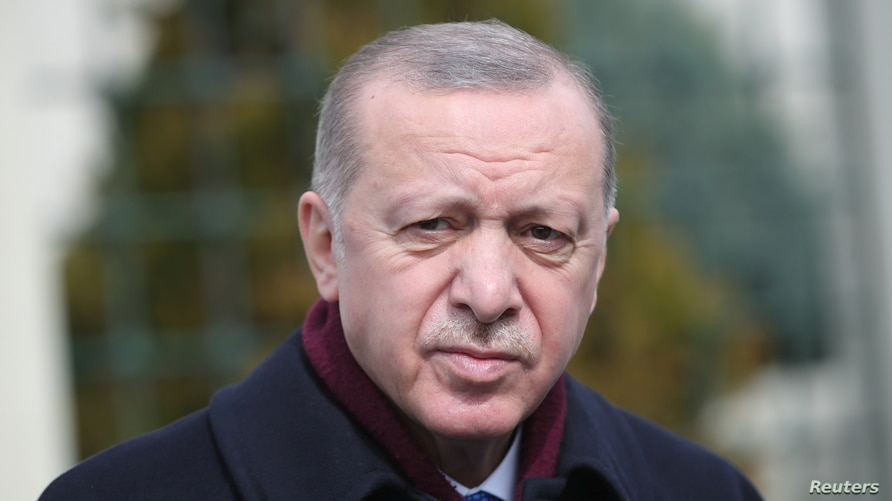 Turkish President Recep Tayyip Erdogan looks on as he addresses the media after the Friday prayers in Istanbul, Turkey March 12…