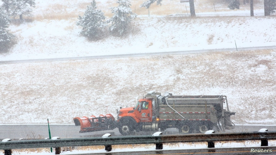 A snowplow patrols U.S. Interstate 70 in Colorado in the initial hours of a winter storm which meteorologists predict could…