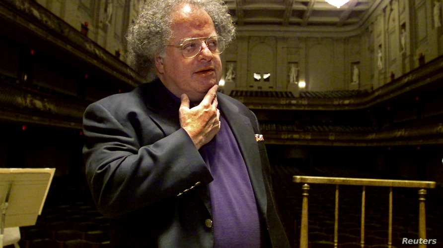 FILE - James Levine pauses as he looks over the stage and conductor's podium in Boston's Symphony Hall after being announced as the next conductor and music director of The Boston Symphony Orchestra, in Boston, Massachusetts, U.S., Oct. 29, 2001.