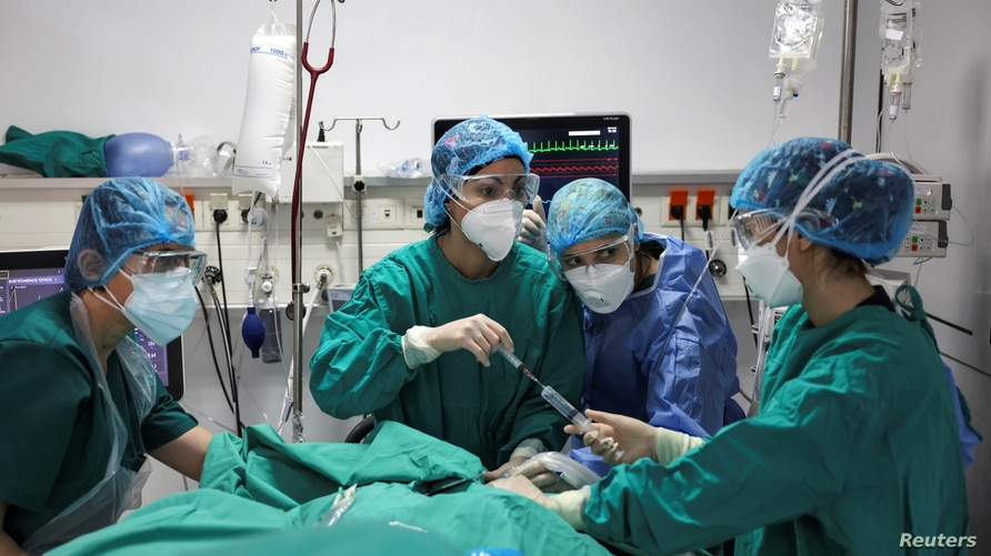 Members of the medical staff treat a patient at the intensive care unit (ICU) of the Sotiria hospital, amid the coronavirus disease (COVID-19) pandemic, in Athens, Greece, March 18, 2021.