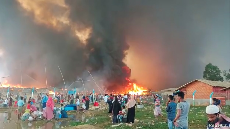 A fire is seen at a Balukhali refugee camp in Cox's Bazar, Bangladesh March 22, 2021. Courtesy of Rohingya Right Team/MD…