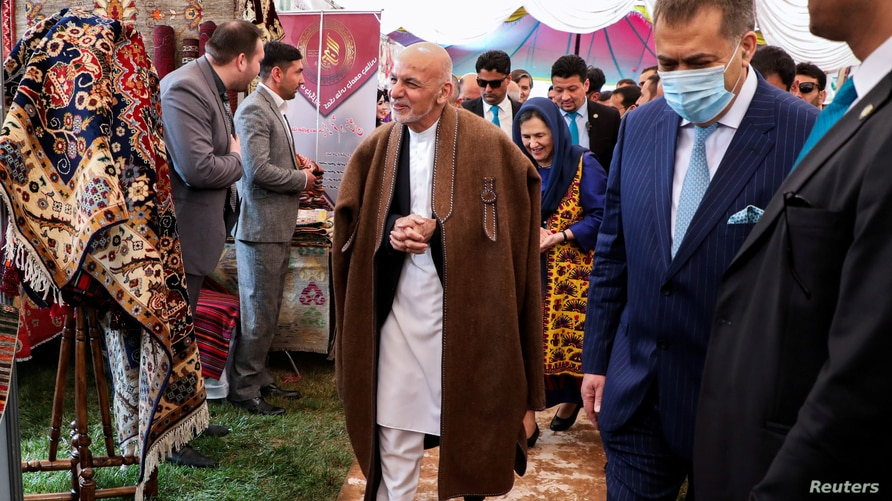 FILE - Afghanistan's President Ashraf Ghani visits an exhibition during celebrations to mark Afghan New Year (Newroz), in Kabul, Afghanistan, March 21, 2021.