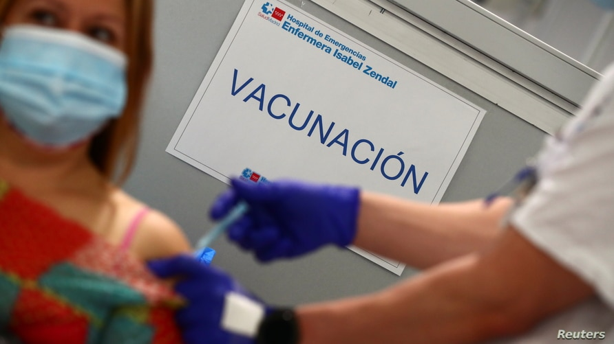 """A sign reading """"Vaccination"""" is pictured as Spain resumes vaccination with AstraZeneca shots after a temporary suspension, amid…"""