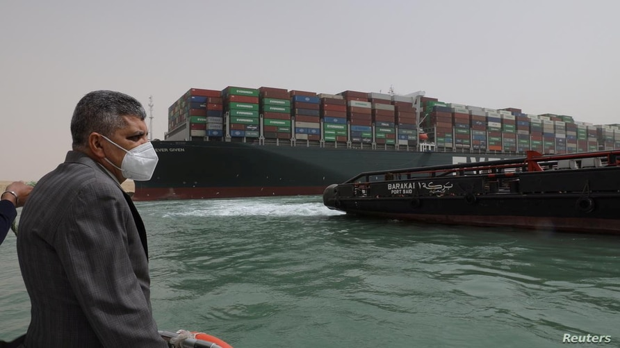 Osama Rabie, Chairman of the Suez Canal Authority, monitors the situation near stranded container ship Ever Given, one of the world's largest container ships, after it ran aground, in Suez Canal, Egypt, March 25, 2021.
