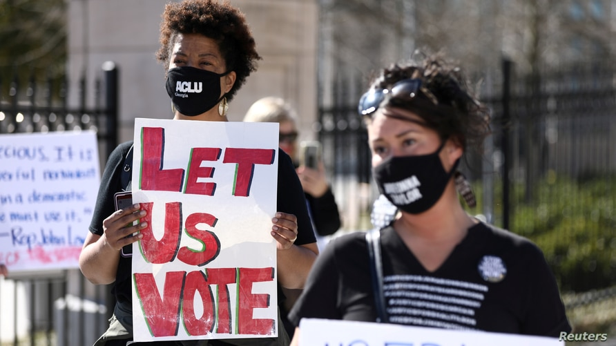FILE PHOTO: Protesters gather outside of the Georgia State Capitol to protest HB 531, which would place tougher restrictions on…