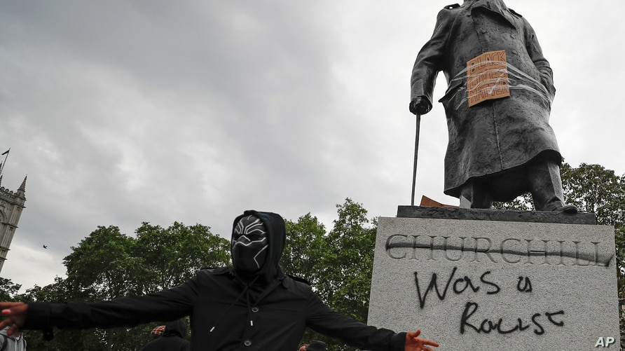 Protesters gather around the Winston Churchill statue in Parliament Square during a Black Lives Matter rally in London June 7, 2020.