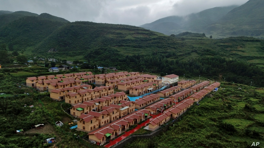 An aerial view shows new village houses built by the Chinese government for ethnic minority in Ganluo county, southwest China's…