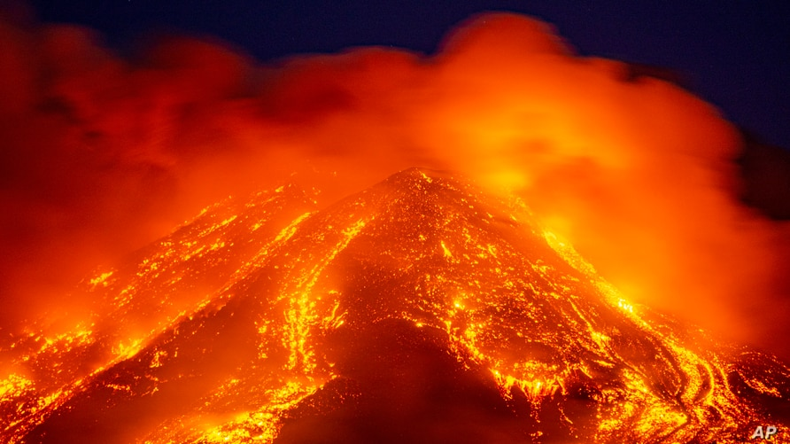 FILE - Lava gushes from the Mt. Etna volcano near Catania, southern Italy, Feb. 16, 2021.