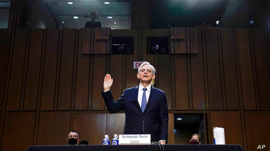 Judge Merrick Garland, nominee to be Attorney General, is sworn in at his confirmation hearing before the Senate Judiciary…