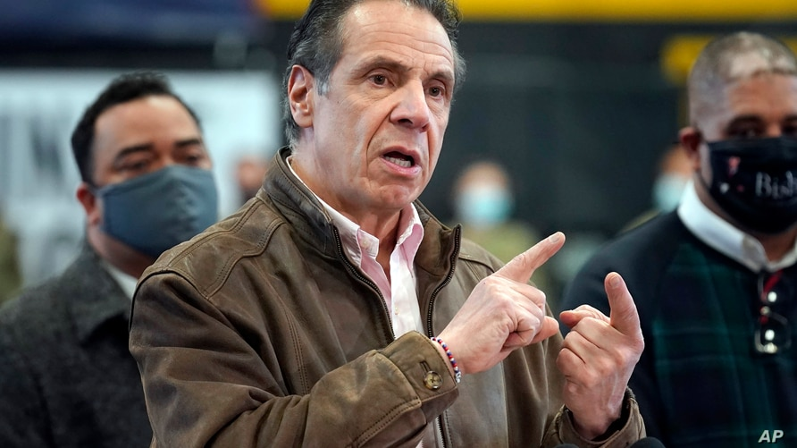 FILE — In this Feb. 22, 2021 file photo, New York Gov. Andrew Cuomo speaks during a news conference at a COVID-19 vaccination…