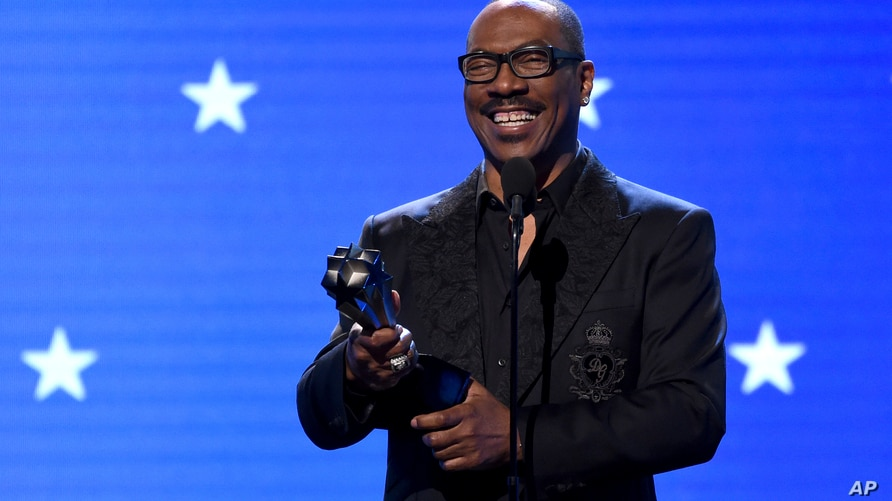 FILE - In this Jan. 12, 2020, file photo, Eddie Murphy accepts the lifetime achievement award at the 25th annual Critics'…