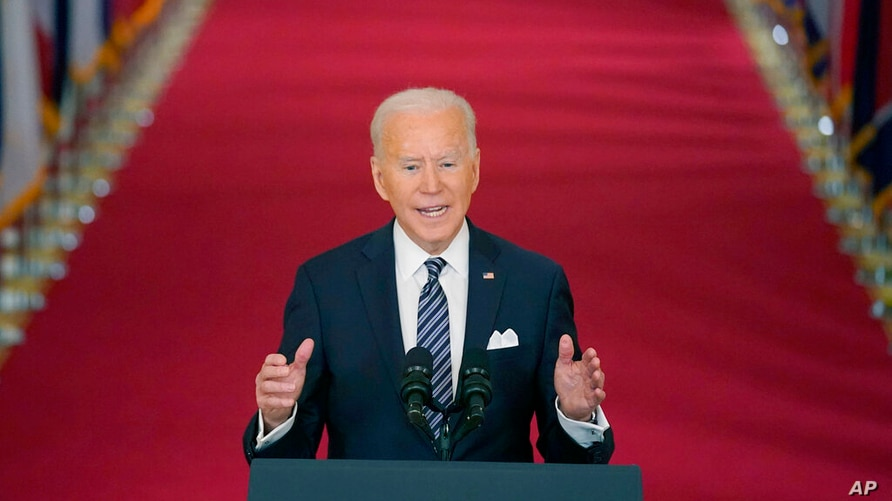 President Joe Biden speaks about the COVID-19 pandemic during a prime-time address from the East Room of the White House,…