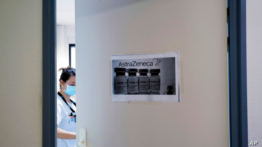 FILE - In this Saturday, Feb. 6, 2021 file photo a health worker closes a door as she prepares doses of the AstraZeneca vaccine…