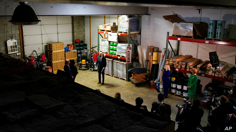 President Joe Biden visits Smith Flooring, Inc., in Chester, Pa., Tuesday, March 16, 2021. The president is joined by owners…