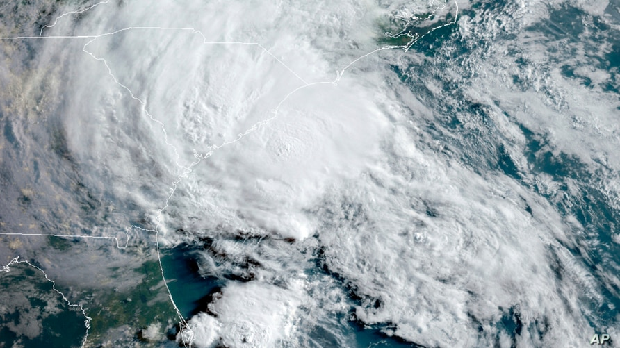 FILE - This May 27, 2020 satellite image made available by the National Oceanic and Atmospheric Administration shows Tropical Storm Bertha approaching the South Carolina coast