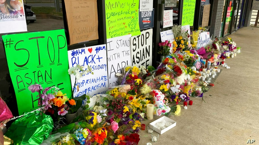 A make-shift memorial is seen Friday, March 19, 2021, in Acworth, Ga., in the aftermath of shootings. Eight people killed…