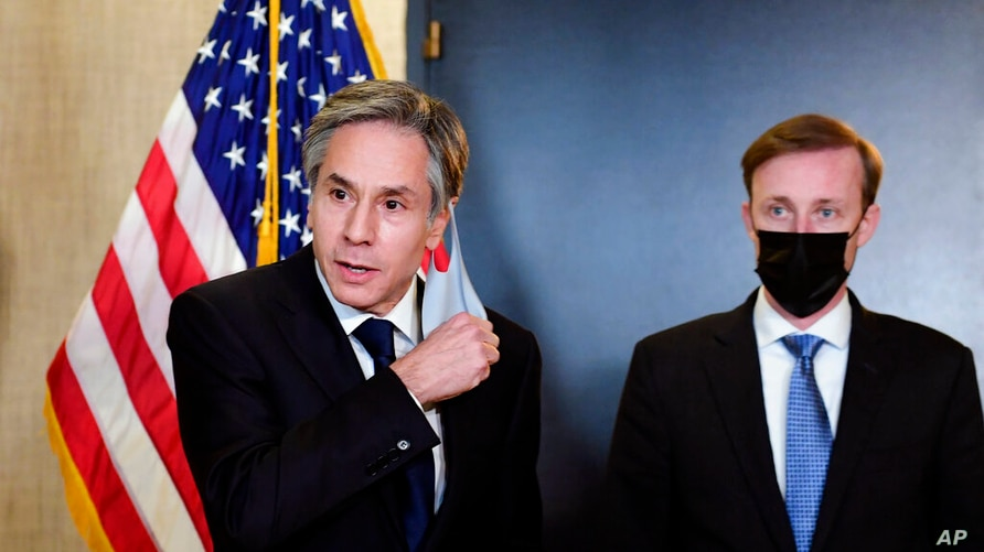 Secretary of State Antony Blinken, accompanied by National Security Adviser Jake Sullivan, right, talks to the media after a…